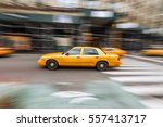 A Taxi Cab Speeds Down In A...
