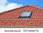 skylight on red ceramic roof... | Shutterstock . vector #557466973