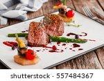 food gourmet veal medallions... | Shutterstock . vector #557484367