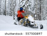 athlete on a snowmobile moving... | Shutterstock . vector #557500897