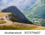 a train descends from the... | Shutterstock . vector #557574607