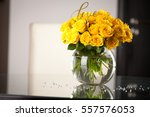 yellow roses in vase on the... | Shutterstock . vector #557576053