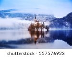 winter landscape bled lake.... | Shutterstock . vector #557576923