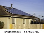 solar panels on the roof of a... | Shutterstock . vector #557598787