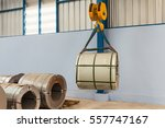 lifting steel coil by overhead... | Shutterstock . vector #557747167