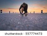 running shoes   man sit down... | Shutterstock . vector #557774473