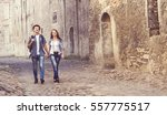traveling couple of hipsters ... | Shutterstock . vector #557775517