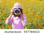 girl holding the camera in the... | Shutterstock . vector #557784013