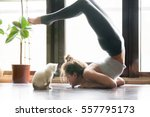 Stock photo young attractive smiling woman practicing yoga stretching in scorpion exercise variation of 557795173