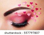 eye make up girl with a heart.... | Shutterstock . vector #557797807