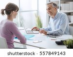 confident advisor meeting with... | Shutterstock . vector #557849143