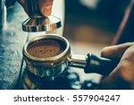 barista holds a portafilter... | Shutterstock . vector #557904247