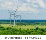 landscape with turbine green... | Shutterstock . vector #557924113