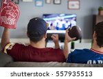 two men with foam hand and... | Shutterstock . vector #557935513