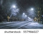snowy road at night in downtown ... | Shutterstock . vector #557986027