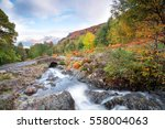 water flowing under ashness... | Shutterstock . vector #558004063