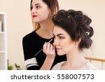 make up artist doing make up...   Shutterstock . vector #558007573