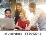 4 people meeting in coffee shop ...   Shutterstock . vector #558042343