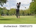 golfers hit sweeping golf... | Shutterstock . vector #558051373