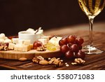 cheese board served with grapes ... | Shutterstock . vector #558071083