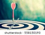 red dart arrow hitting in the...   Shutterstock . vector #558150193