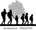 family reaching with backpacks... | Shutterstock .eps vector #558162733