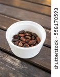 Raw Cocoa Beans In White...