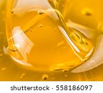 macro abstract of golden honey   Shutterstock . vector #558186097