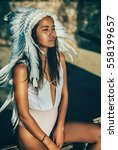 Small photo of Woman in costume of American Indian