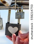 Hand Touches Padlock With Hear...