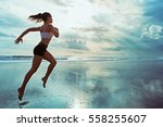 Small photo of Active sporty woman run along ocean surf by water pool to keep fit and health. Sunset black sand beach background with sun. Woman fitness, jogging workout and sport activity on summer family holiday.