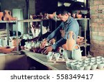 two active craftsmen with... | Shutterstock . vector #558349417