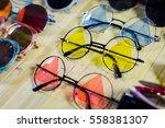 fashion sunglasses in shop.... | Shutterstock . vector #558381307