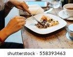 woman eating vegetarian pizza... | Shutterstock . vector #558393463