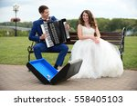 bride and groom playing the... | Shutterstock . vector #558405103