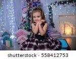 child girl in a christmas... | Shutterstock . vector #558412753