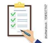 hand filling checklist on... | Shutterstock .eps vector #558527707