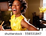 woman cooking in a kitchen. | Shutterstock . vector #558531847