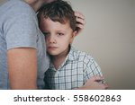 sad son hugging his mother at... | Shutterstock . vector #558602863