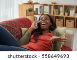 woman laughing when talking on... | Shutterstock . vector #558649693