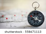 magnetic compass on a world map ... | Shutterstock . vector #558671113