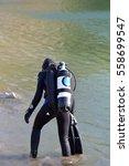beautiful caucasian diver woman ... | Shutterstock . vector #558699547