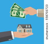 hands with money and house.... | Shutterstock . vector #558703723