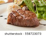 tenderloin steak on plate | Shutterstock . vector #558723073