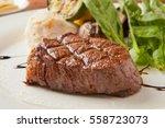 tenderloin steak on plate | Shutterstock . vector #558723073