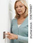 mature woman turning off light... | Shutterstock . vector #558749887