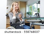 disabled woman in wheelchair... | Shutterstock . vector #558768037