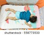 a baby sleeping | Shutterstock . vector #558773533