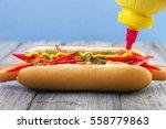adding mustard to very spicy...   Shutterstock . vector #558779863