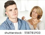 mother arguing with teenage son | Shutterstock . vector #558781933